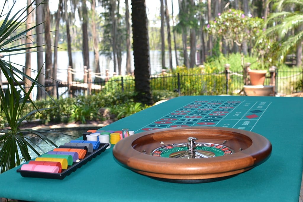roulette table outside under palm tree