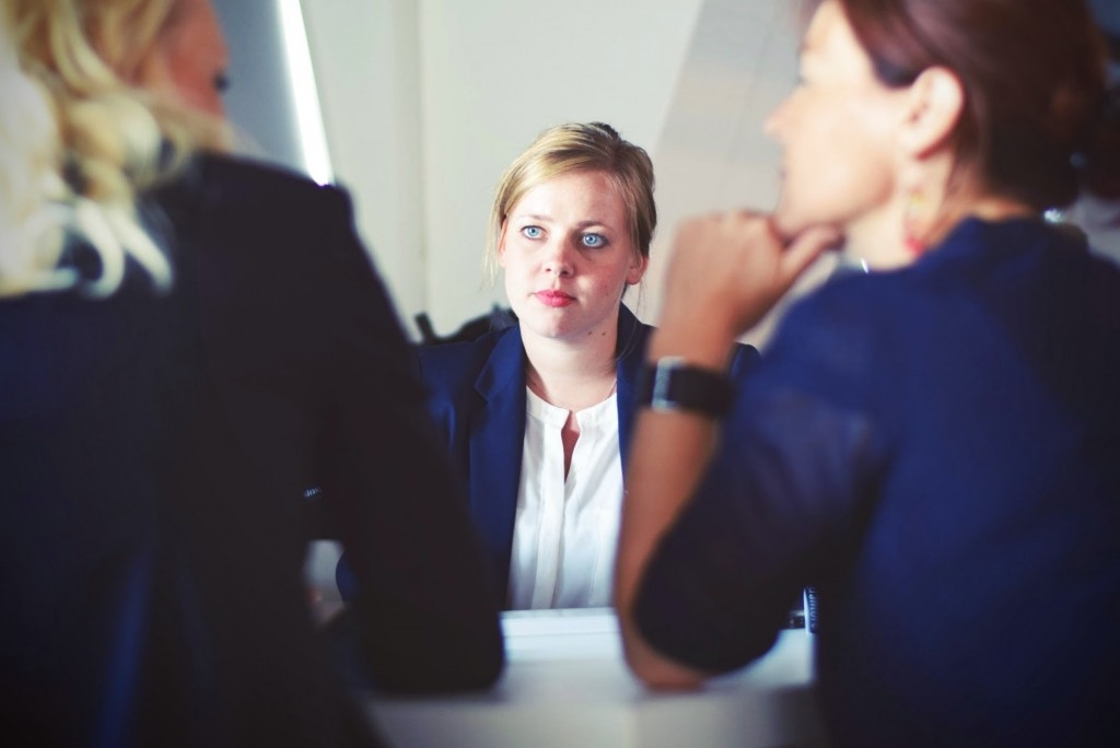 woman attending interview with two interviewers