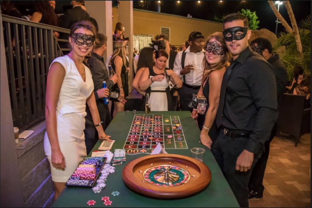 people wearing masks at roulette table