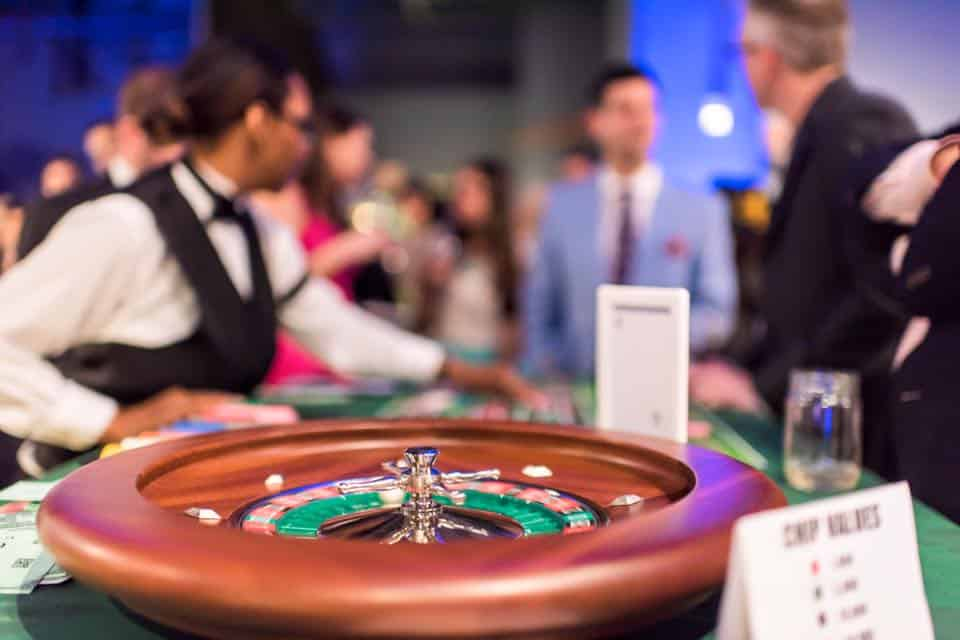 casino night with roulette wheel in foreground