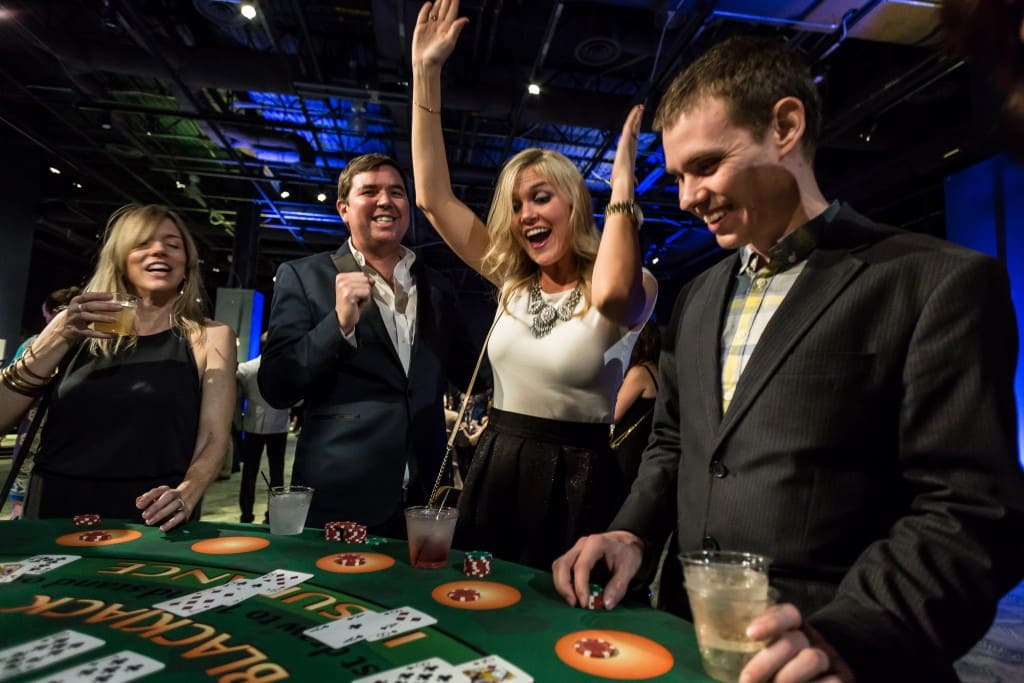 people celebrating at blackjack table