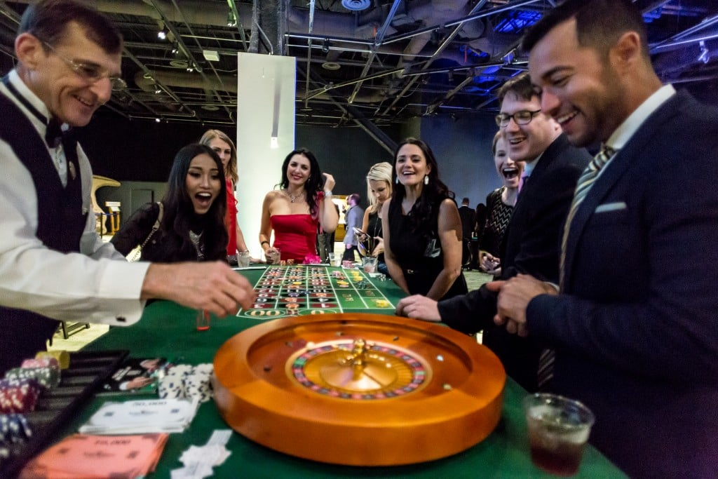 excited people at roulette table
