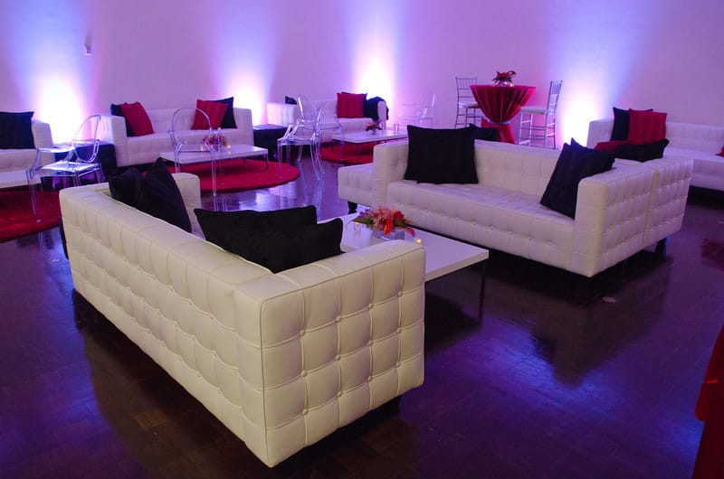 white couches with cool uplighting