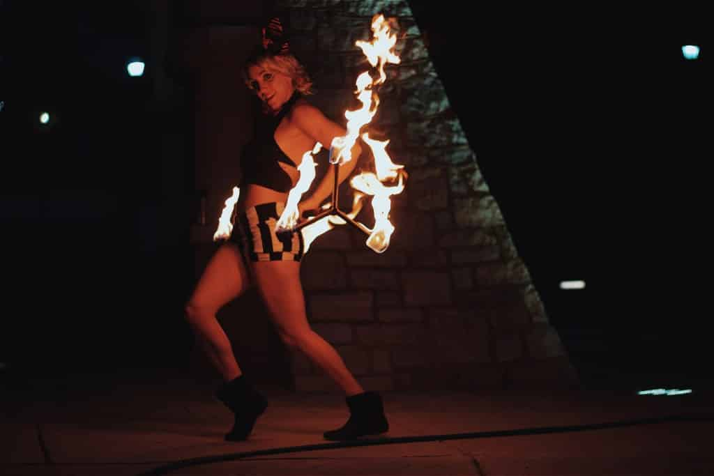 Female Fire twirling entertainer at party