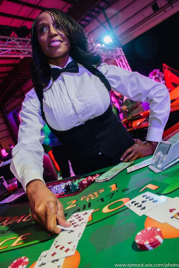 Female black jack dealer laying down cards