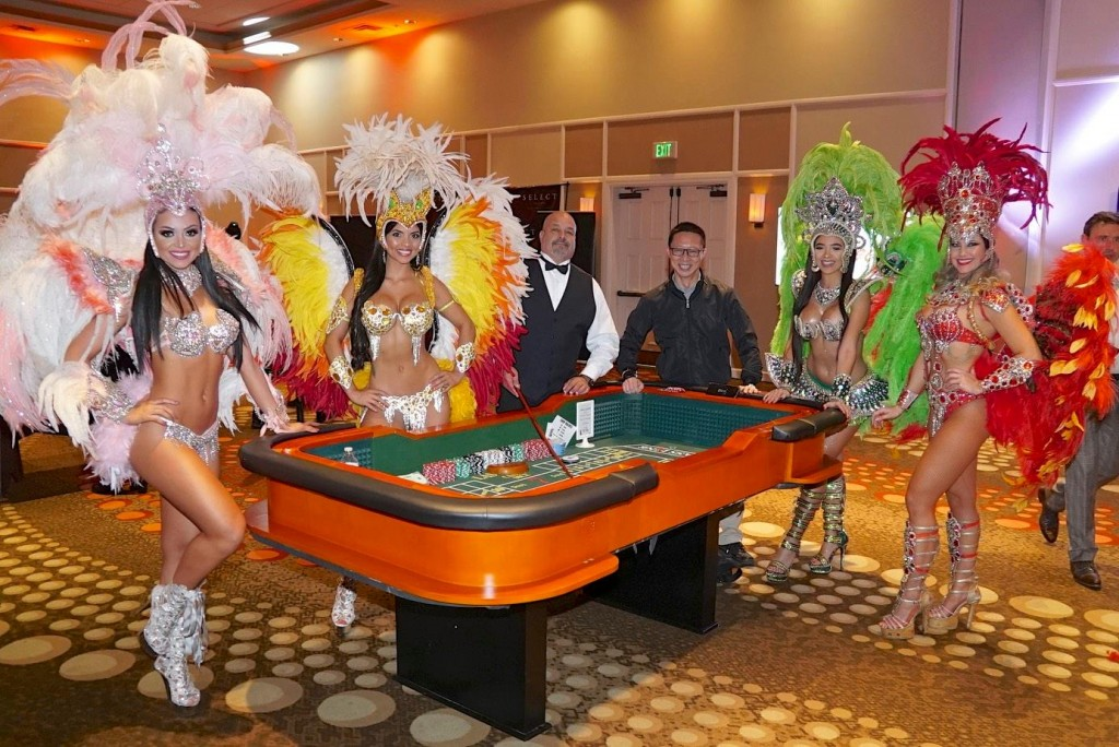 Vegas-style showgirls around craps table
