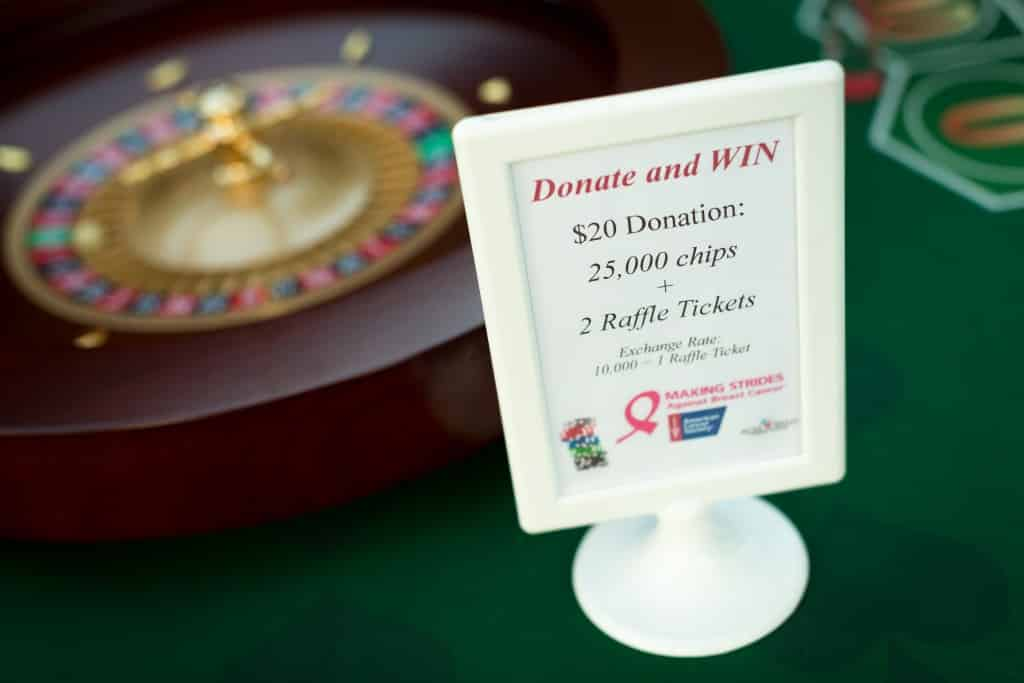 donation sign next to roulette wheel